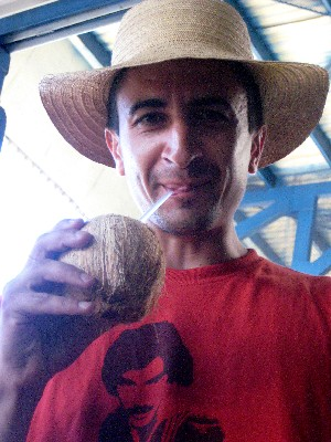 Drinking fresh coconut to beat the heat at a border stop rushing through Central America